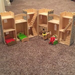 Melissa and Doug castle with figures